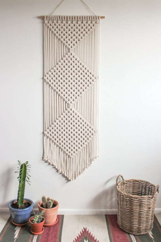 a beautiful macrame wall hanging is a cool idea for a boho space, it will add interest to the space