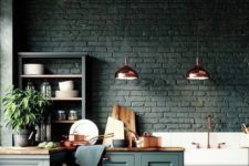 16 a black brick backsplash matches the forest green cabinets and wooden countertops creating a moody feel in the space