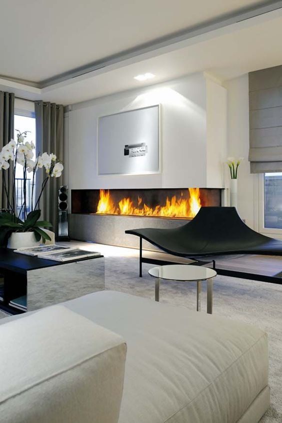 a large minimalist built-in fireplace in the living room is a stylish and bold idea with a modern feel