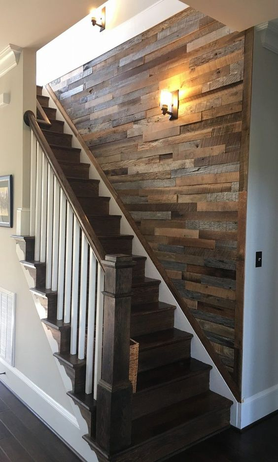 a reclaimed wooden wall over the staircase is a cool way to add interest to this blank wall and make the space cozy