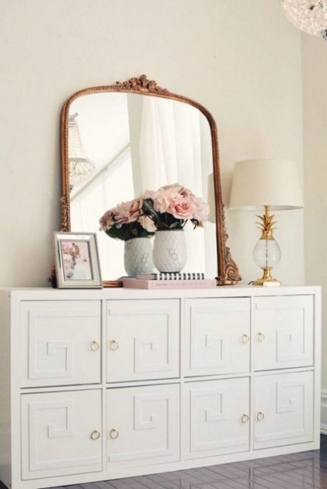 an IKEA Malm dresser turned into a chic vintage piece with overlays and brass knobs for a refined touch