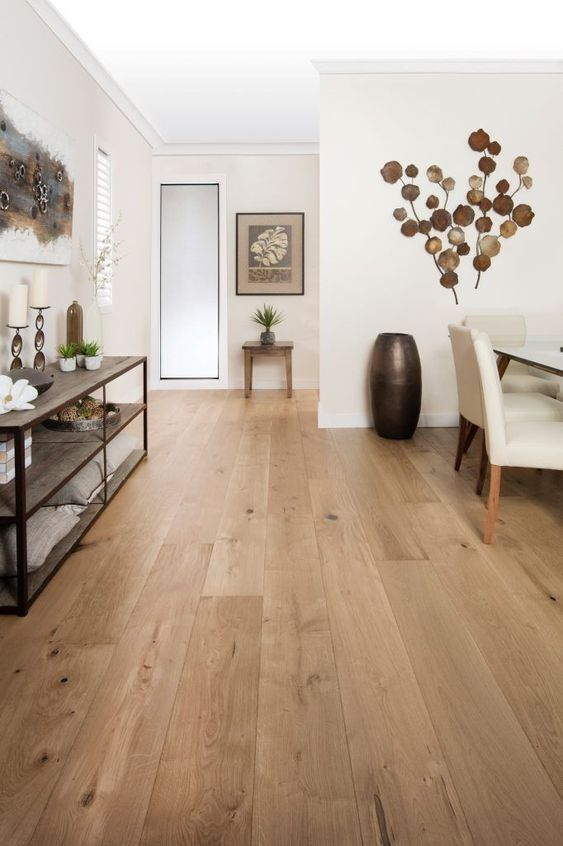 finish a neutral space with a neutral and warm-toned hardwood floor to make it more welcoming and cozy