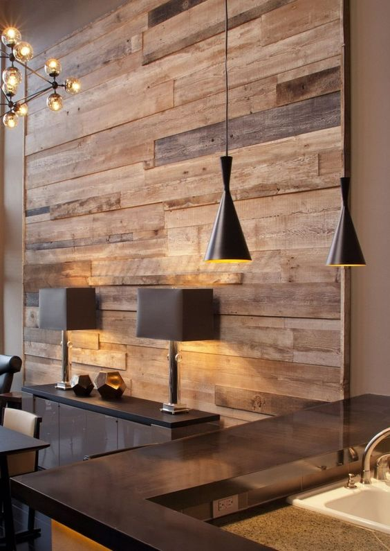 a reclaimed wood wall gives this space comfiness, warmth and looks textural and cozy, not too formal