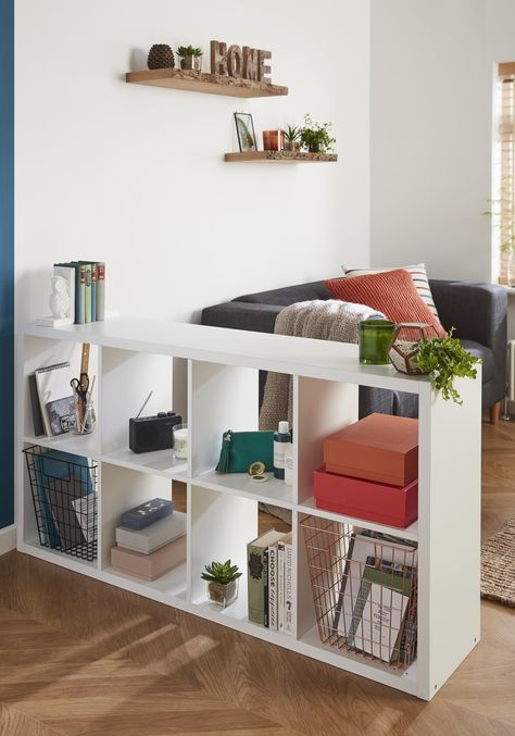 a simple open storage unit liek this one can be easily DIYed for separating your spaces