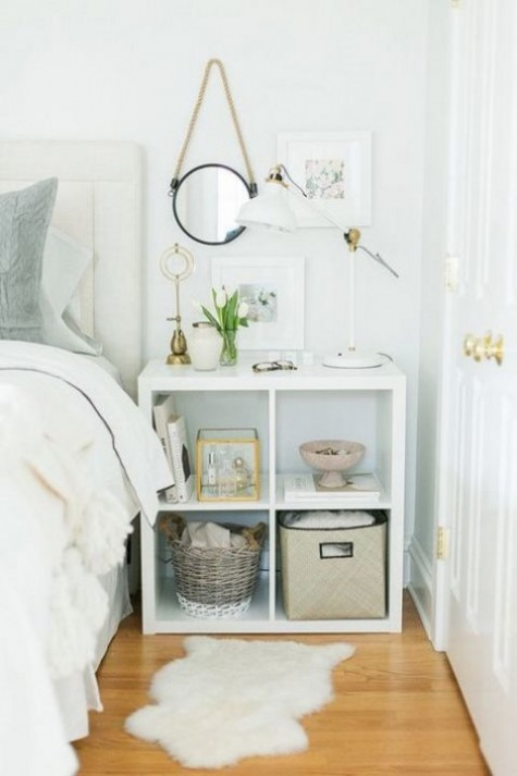 an IKEA Kallax shelf used as a stylish nightstand with much open storage that will fit most of bedrooms