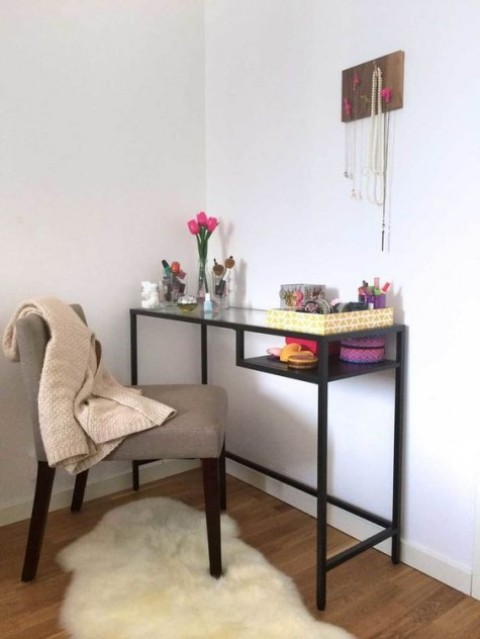 a black IKEA Vittsjo desk used as a vanity – just add a comfy chair and you have a gorgeous space for makeup