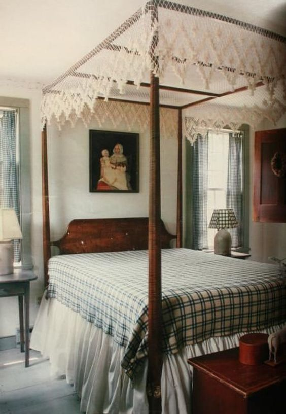 a lace cover gives this vintage bedroom a boho and rustic feel making it even cozier than it is