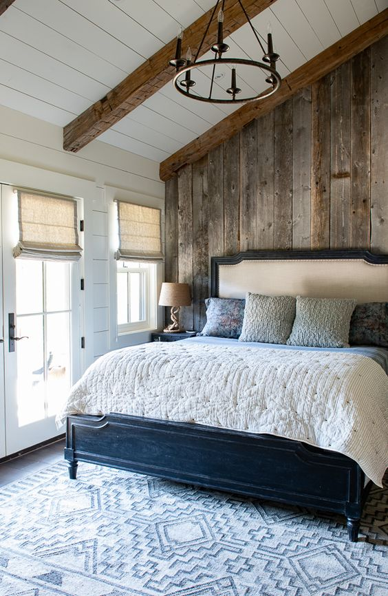 a relaimed wooden wall and matching wooden beams make the space very cozy and warm