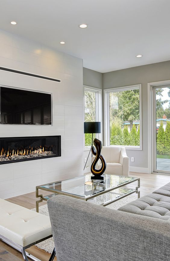 a white built-in minimalist fireplace under the TV is a stylish and elegant idea that adds coziness