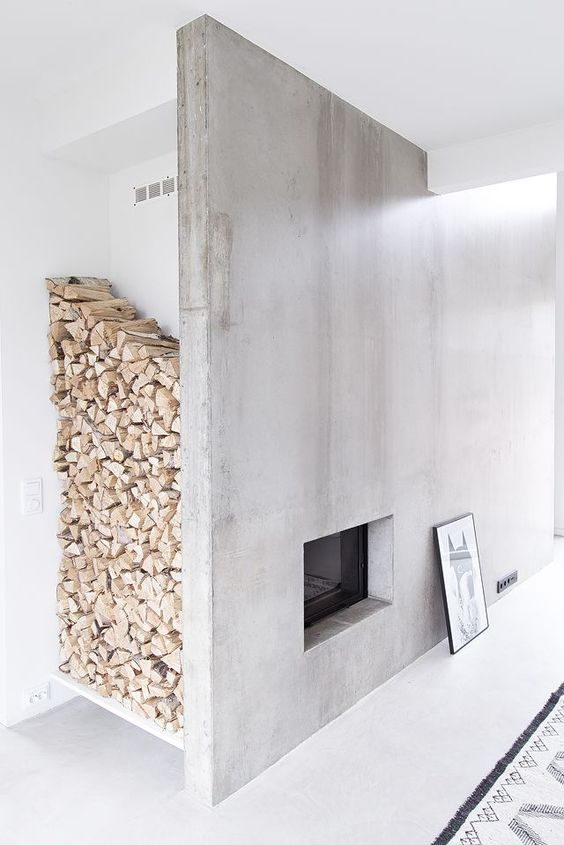 a concrete fireplace with a large firewood storage space by the corner is a very chic idea to go for