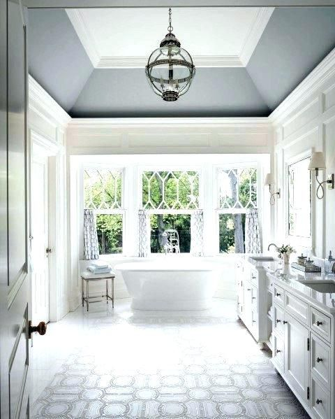 crown molding will fit most of spaces even bathrooms and will give an elegant look and feel to it