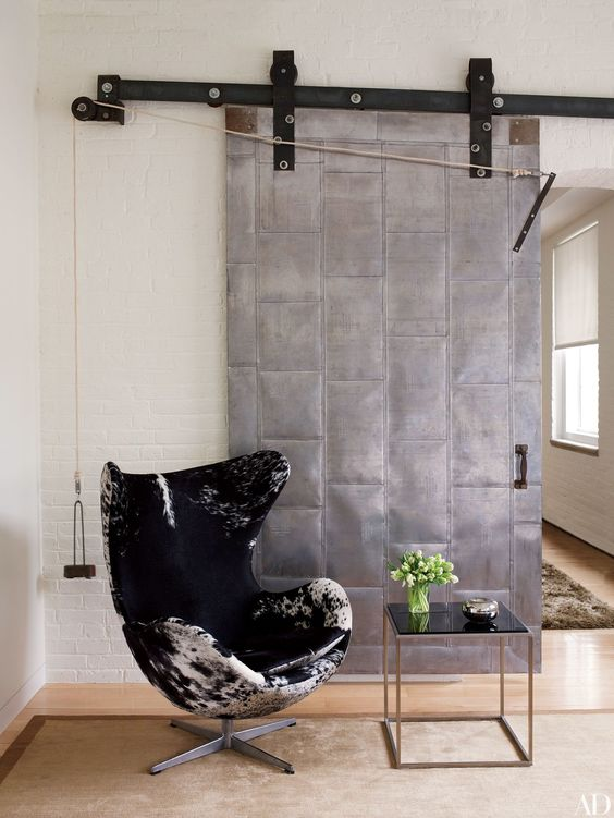 a sliding metal door will add a strong industrial feel to your space making it bolder