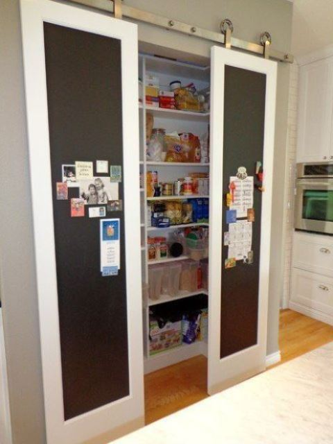a small built in pantry with sliding chalkboard doors   leave your notes, lists and pics on them