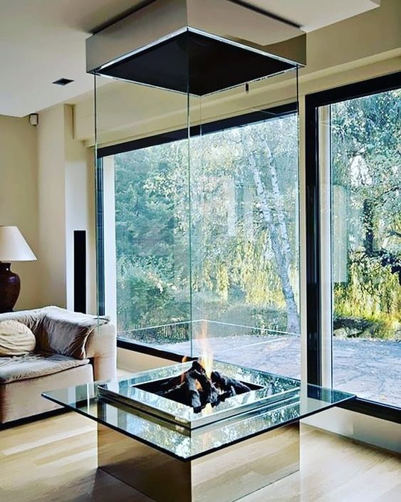 a spectacular glass encased fireplace is a statement piece in any living room