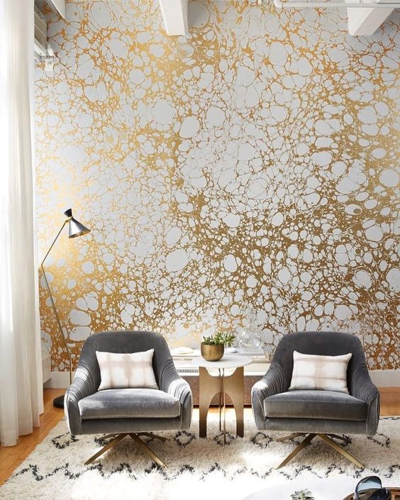 a printed gold and white wallpaper wall will make your living room very bold and stylish