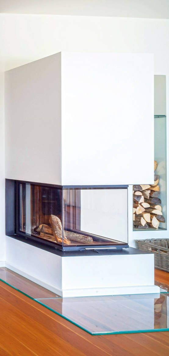 a stylish minimalist glass-encased fireplace is a perfect solution for a contemporary space