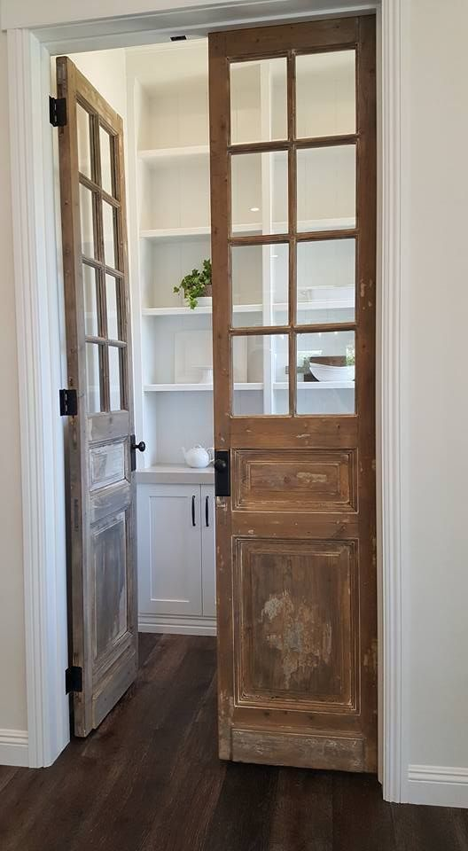 vintage French doors will let you see what's inside the pantry giving the space truly French chic