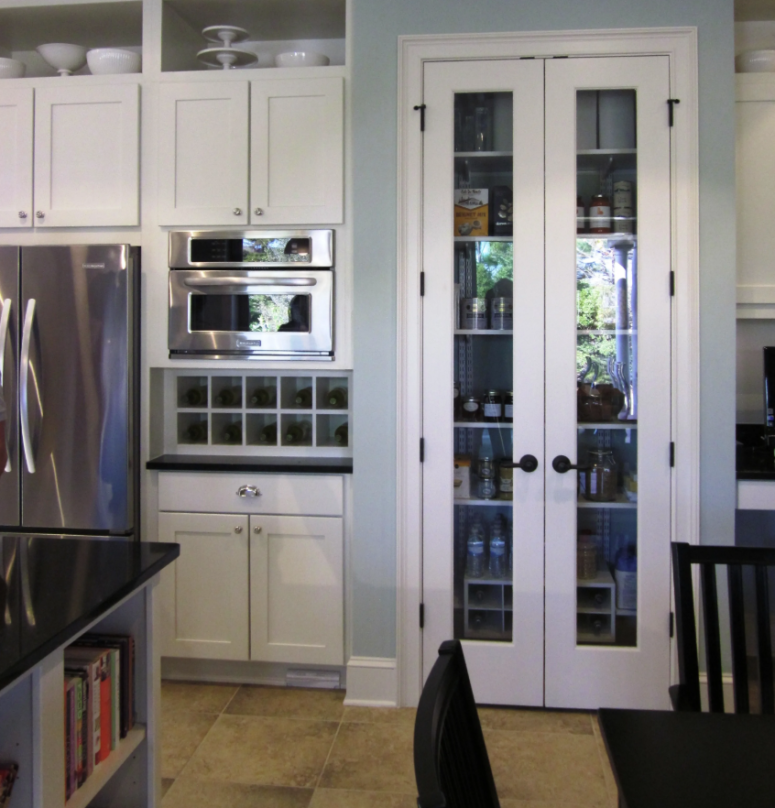 a stylish built-in pantry with matching French doors - these work for most of interiors