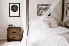 23 sheer and airy white curtains add a decorative effect to the space without separating the bed from the rest of the space