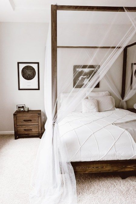 sheer and airy white curtains add a decorative effect to the space without separating the bed from the rest of the space