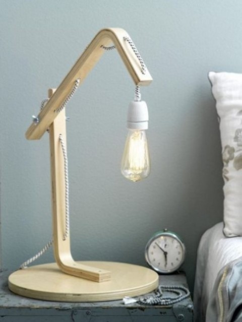 a bedside lamp made of an IKEA Frosta stool for a chic an industrial touch in your bedroom
