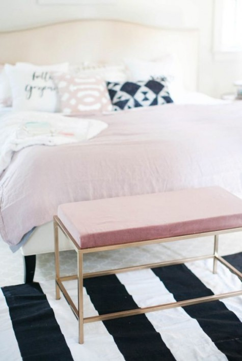 an IKEA Fjallbo coffee table renovated into a chic and glam pink bench at the foot of the bed