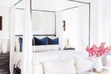 25 style your canopy bed with simple flowy white curtains for some privacy and to make the space cozier