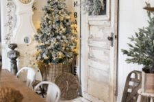 26 neutral farmhouse dining room decor with evergreens, a flocked Christmas tree with lights, an ornament garland and a basket