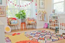 a bright nursery with layered colorful rugs, bright bedding and pillows, bright garlands and toys