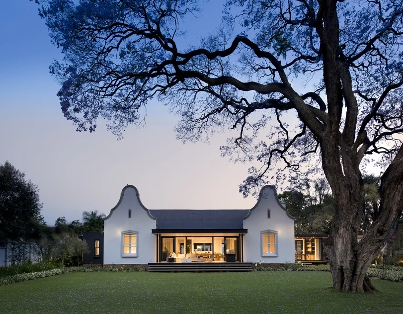 This 1900 farm house was transformed into a contemporary home but its exterior was saved and restored
