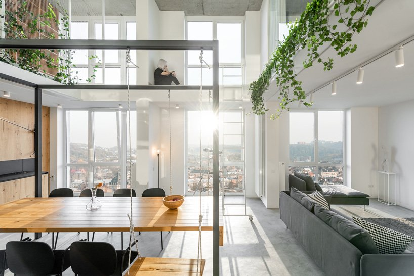This contemporary apartment is done with double height ceilings, large windows and creative solutions