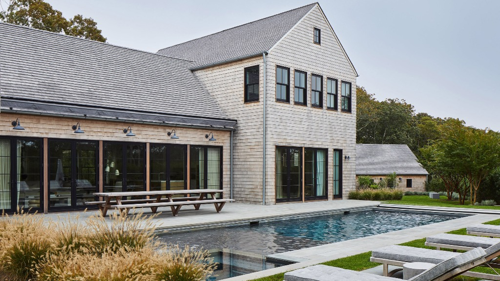 This house in fully clad with white cedar to match the vernacular style of the place