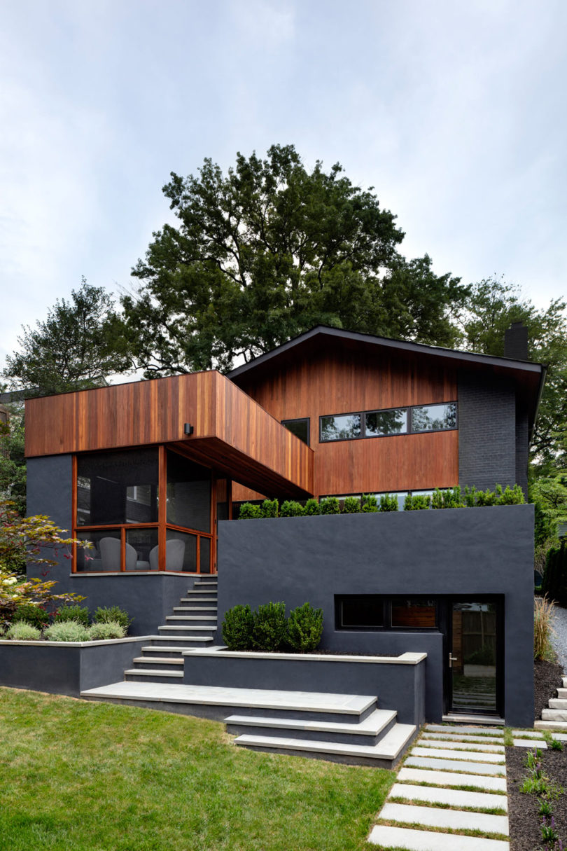 The exterior of the house is done in black and rich colored wood
