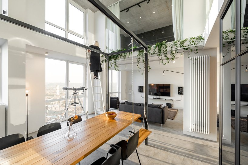 This layout includes a living room and a dining space, some cascading greenery and you can see a glazed second floor