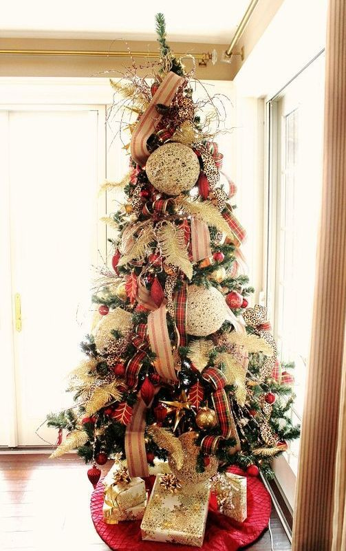 a bold and eye-catchy Christmas tree with striped and plaid ribbons, feathers, red and gold ornaments and oversized white ones