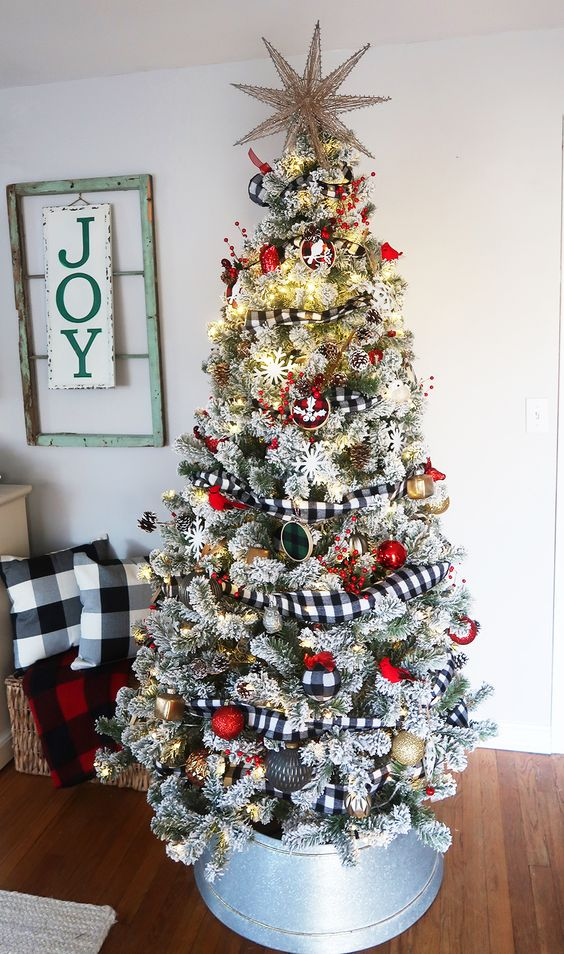 a flocked Christmas tree with buffalo check ribbons and matching ornaments plus matching pillows