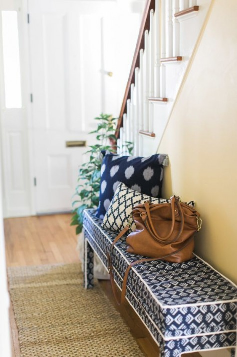 an IKEA Bjursta bench hack with printed navy and white fabric for a mudroom that lacks a sitting piece