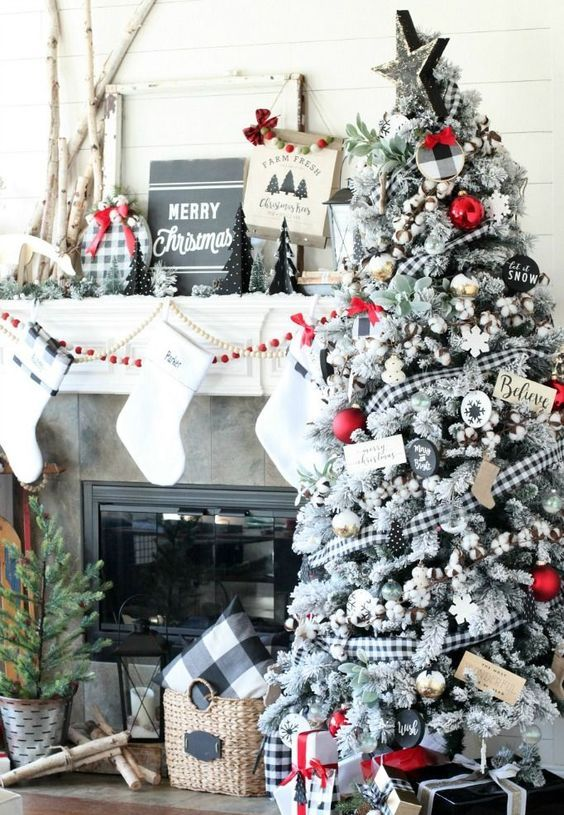 a flocked Christmas tree with cotton, buffalo check ribbons, red garlands and other touches for a contrast