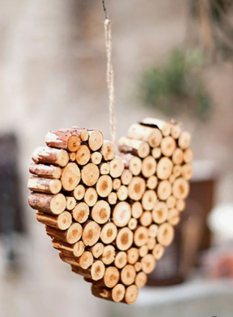 a heart-shaped Christmas ornament made of wood sticks and twine is very homey and you can easily DIY it
