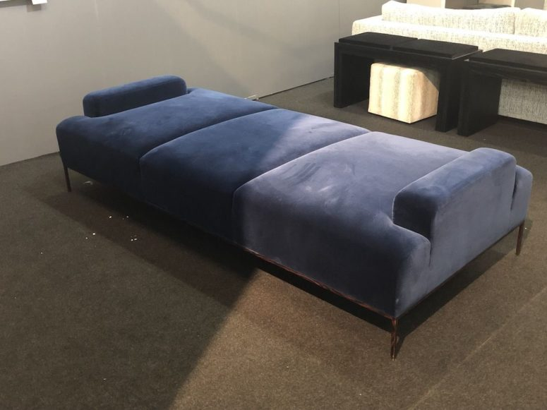 an upholstered classic blue daybed will add color and comfort to your space adding chic and an edgy touch