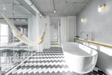 04 The bathroom is hidden behind glass doors and can be made private with curtains, there's a hammock for relaxation