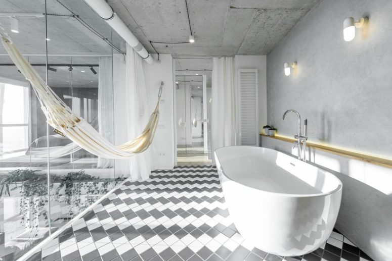 The bathroom is hidden behind glass doors and can be made private with curtains, there's a hammock for relaxation