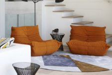 04 There are some bright and bold accents, and these orange chairs are among them
