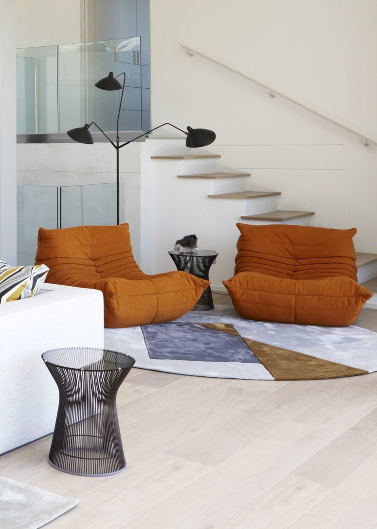There are some bright and bold accents, and these orange chairs are among them