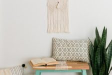 04 a DIY IKEA Skogsta bench hack with bright paint and rope will fit a boho entryway easily