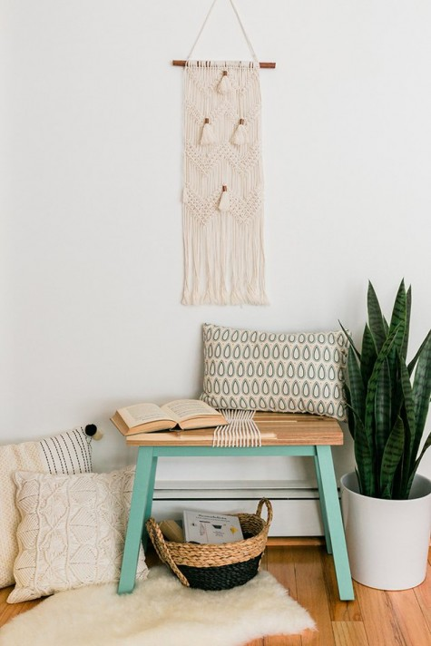 a DIY IKEA Skogsta bench hack with bright paint and rope will fit a boho entryway easily
