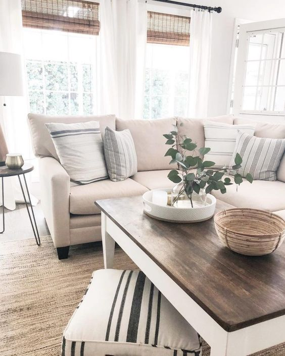 a chic neutral living room with much texture of various materials and fabric and stripes looks very cozy