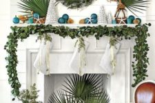 04 a greenery garland on the mantel, a greenery wreath and tropical leaves for beach Christmas styling