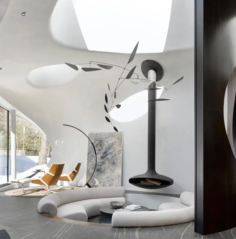 The living space also features a sitting zone by the glazed wall, some skylights and a statement artwork