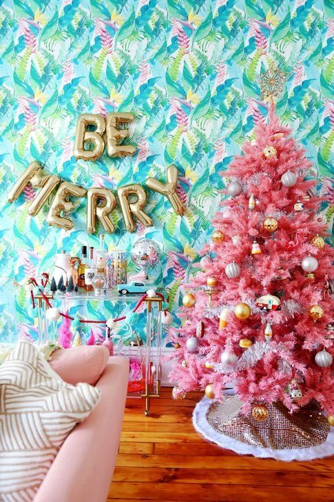a pink tree decorated with metallic ornaments is a cheerful and bright decor idea to go for
